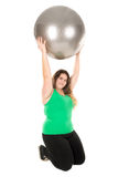 Large girl with exercise ball Stock Photo