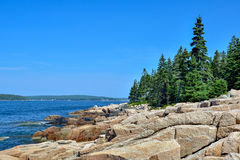 Large Glacial boulders of Pink Granite line the shores of French Stock Photos