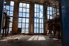 Large glas window. Inside industrial interior angle shot stock photography