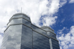 Large Glass Building. A large glass building with two spires Stock Images