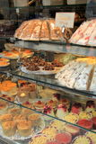 Large glass case with specialty pastries Stock Photo