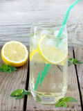 Large glass of cold lemonade with ice, lemon, mint leaves Stock Image