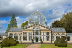 A large glass conservatory with a natural setting Stock Photography