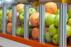A large glass container showcase fresh fruit apples and oranges Royalty Free Stock Photo