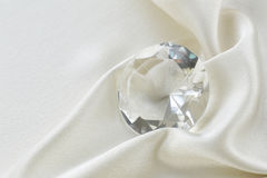 Large glass diamond on silk background Stock Photography
