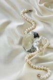 Large glass diamond on silk background Stock Image