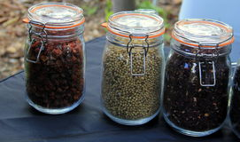 Large glass jars filled with a variety of spices Stock Photo