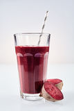 Large glass of nutritious root vegetable drink Stock Photography