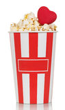 Large glass of popcorn with red heart isolated on white Stock Photos