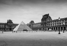 The large glass pyramid and the main courtyard of the Louvre Museum. Stock Photos