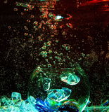 Large glass transparent ball inside the water with air bubbles a. Nd colorful pieces of artificial ice Stock Photography