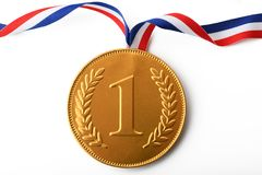 Large gold first prize medal with ribbon. A Large gold first prize medal with ribbon stock image