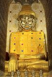 Large golden Buddha at the temple Myanmar. royalty free stock photo