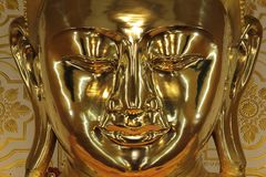 Large golden Buddha statue at Myanmar stock photo