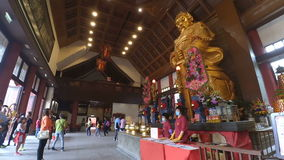 The large golden Che Kung God statue at Che Kung Temple stock video