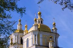 Golden domes of the city cathedral. Large, golden domes of the central cathedral of the city against the blue sky stock photos