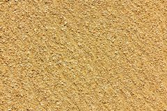 Large Golden sand of the sea, the surface of the sea coast, texture, background royalty free stock photography