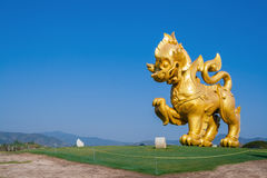 Large golden singha in the blue sky Stock Photo