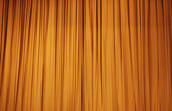Large golden stage curtain Royalty Free Stock Images