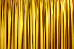 Large golden stage curtain. In cinema Stock Photo