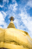 Large golden temple with sky background, Name is Phra Maha Chedi Stock Photo