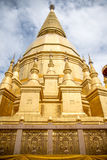 Large golden temple with sky background, Name is Phra Maha Chedi Stock Image