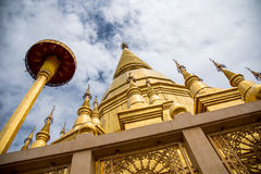 Large golden temple with sky background, Name is Phra Maha Chedi. Phra Maha Chedi Srivang Chai, Golden temple for buddhism to pray for faith Royalty Free Stock Photo