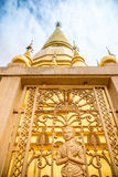 Large golden temple with sky background, Name is Phra Maha Chedi Royalty Free Stock Images