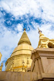 Large golden temple with sky background, Name is Phra Maha Chedi. Phra Maha Chedi Srivang Chai, Golden temple for buddhism to pray for faith Royalty Free Stock Photography