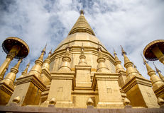 Large golden temple with sky background, Name is Phra Maha Chedi Stock Photos