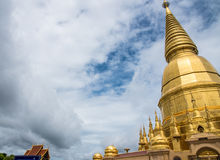 Large golden temple with sky background, Name is Phra Maha Chedi. Phra Maha Chedi Srivang Chai, Golden temple for buddhism to pray for faith Stock Image