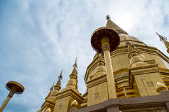 Large golden temple with sky background, Name is Phra Maha Chedi. Phra Maha Chedi Srivang Chai, Golden temple for buddhism to pray for faith Royalty Free Stock Image