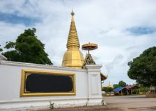 Large golden temple with sky background, Name is Phra Maha Chedi Srivang Chai, Located in Lamphun, Thailand. Royalty Free Stock Images