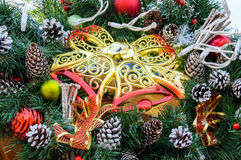 Large golden tracery plastic bells, fir branches, cones - festive decorations for the New Year, Christmas. Royalty Free Stock Images