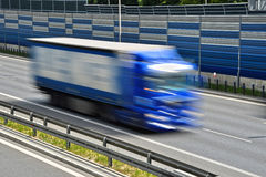 Large goods vehicle moving at full speed on six lane highway Stock Photos