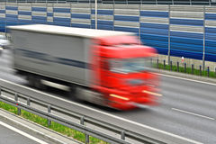Large goods vehicle moving at full speed on six lane highway Royalty Free Stock Image