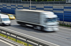 Large goods vehicle moving at full speed on six lane highway Royalty Free Stock Images