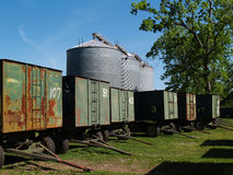 Large Grain Silos behind Peanut Wagons and a Pecan Royalty Free Stock Photo
