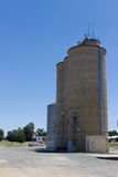Large Grain Silos. Large steel grain silos with cloudless blue skies Stock Photography