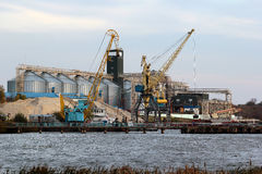 Large grain terminal with cranes and silos Stock Images
