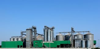 Large grains storage bin system with several silos of different sizes, drying towers and distribution systems.  stock photography