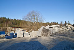 Large granite blocks in a stone quarry. The quarry is located on Ystehede in Halden municipality. Norway. In the quarry the stones are brokenfor building and Royalty Free Stock Images