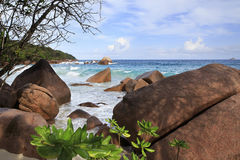 Large granite boulders on the beach of Anse Lazio Stock Photography
