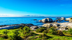 Large granite boulders at Boulders Beach, home to a colony of African Penguins Royalty Free Stock Images