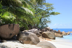 Large granite boulders in Indian Ocean on the Royalty Free Stock Photos