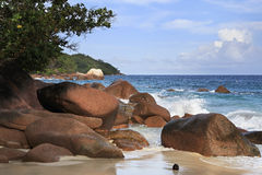 Large granite boulders in Indian Ocean on the Royalty Free Stock Images