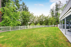 Large grass filled back yard. Royalty Free Stock Image