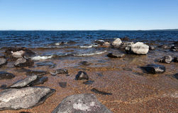 Large gray rocks on the shore of Lake Royalty Free Stock Images