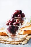 Large greek kalamata olives, gray background, selective focus. Food still life royalty free stock image
