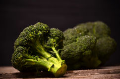 Large green broccoli on a black background Stock Photo